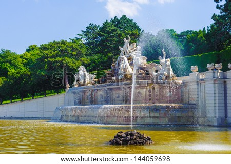 VIENNA, AUSTRIA - JUNE 17: Neptun fountain in the gardens of Schonbrunn Palace on June, 17, 2013 in Vienna, Austria. It was a royal residence of Franz Joseph and Elisabeth - stock photo