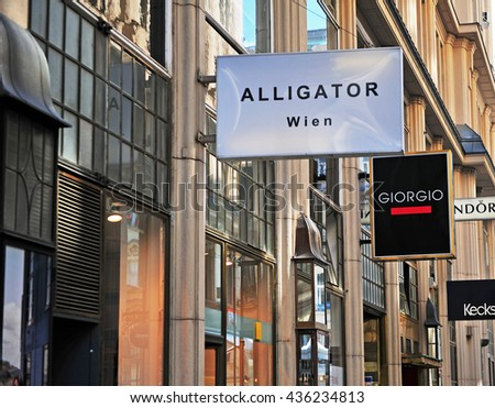 VIENNA, AUSTRIA - JUNE 6: View of the shopping street with shop labels in Vienna on June 6, 2016.