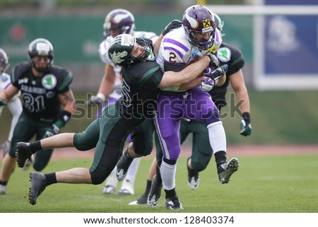 VIENNA, AUSTRIA - MARCH 31 RB Dusty Thornhill (#2 Vikings) is tackled by LB Jakob Baran (#15 Dragons) on March 31, 2012 in Vienna, Austria. - stock photo