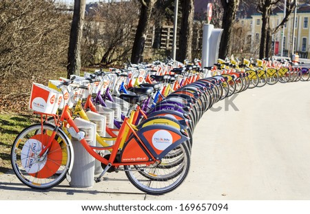 "VIENNA, AUSTRIA - MARCH 7 : Station of ""Citybike"" bicycles in Vienna - public bike rental system that allows one to visit Vienna�s sights by bicycle on March 7th, 2013 in Vienna, Austria - stock photo"