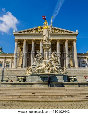 VIENNA, AUSTRIA, MAY 15, 2015: Austrian parliament building with famous Pallas Athena fountain and main entrance in Vienna, Austria