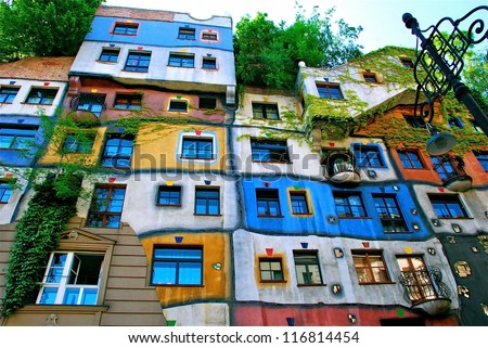 VIENNA, AUSTRIA - MAY 14: Hundertwasser Haus on May 14, 2008 in Vienna. Designed by the well known Austrian artist and architect Friedensreich Hundertwasser with the architect Josef Cravinho - stock photo