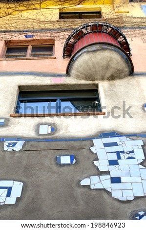 VIENNA, AUSTRIA - MAY 5: Hundertwasser House on May 5, 2014 in Vienna. Hundertwasser claimed that architecture should not conformed to straight lines and flat floors as it is going against nature.