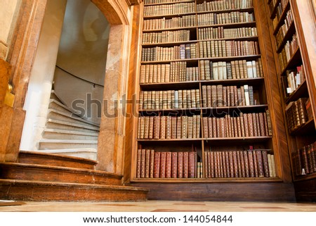 VIENNA, AUSTRIA - MAY 30: Old staircase and the books in the beautiful Austrian National Library on May 30, 2013 in Vienna. Est in 18th century, the largest library in Austria with 7.4 mill items - stock photo
