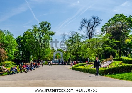 VIENNA, AUSTRIA, MAY 15, 2015: People are relaxing in stadtpark in vienna during sunny day in early summer