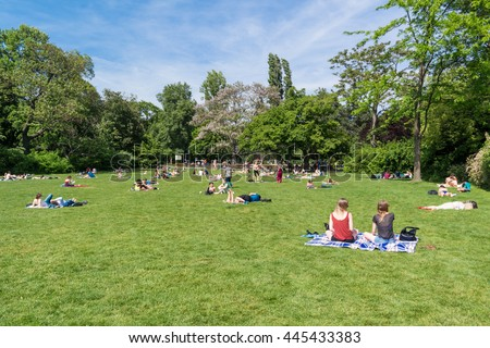 VIENNA, AUSTRIA - MAY 22, 2016: People relaxing and enjoying nice weather on a Sunday afternoon in Stadtpark, City Gardens, in Vienna, Austria
