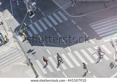 VIENNA, AUSTRIA - MAY 29, 2012: Some people crossing the Gumpendorfer street in the 6th district of Vienna at a sunny da.