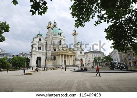 VIENNA, AUSTRIA - MAY 31. St. Charles's Church (Karlskirche) in Vienna, Austria on May 31, 2012. Cathedral was built 1737. Vienna has over 10 million visitors a year. - stock photo