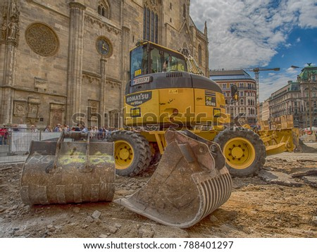 Vienna, Austria - May 23, 2017: Yellow digger working on the square before St. Stephen's Cathedral in Vienna