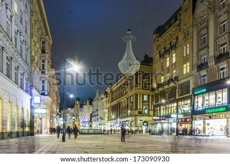 VIENNA, AUSTRIA - NOV 25: Vienna - famous Graben street at night with rain reflection on the cobbles on November 25, 2009 in Vienna, Austria. - stock photo