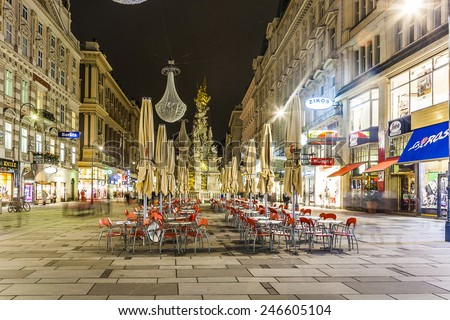VIENNA, AUSTRIA - NOV 5, 2009: Vienna - famous Graben street at night with rain reflection on the cobbles in Vienna, Austria. - stock photo