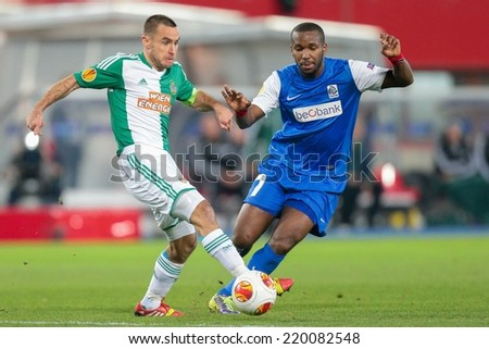 VIENNA, AUSTRIA - NOVEMBER 7 Khaleem Hyland (#7 Genk) and Steffen Hofmann (#11 Rapid) fight for the ball at a UEFA Europa League game on November 7, 2013 in Vienna, Austria. - stock photo