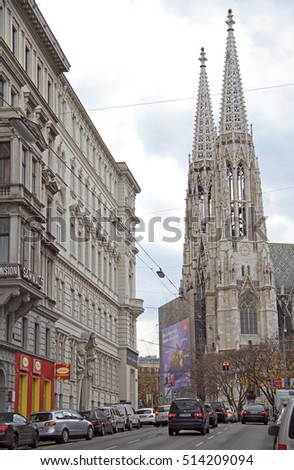 VIENNA, AUSTRIA - NOVEMBER 9, 2015: people are moving in cars nearly Votive Church in Vienna, Austria