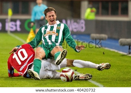 VIENNA,  AUSTRIA - NOVEMBER 5: SK Rapid loses 0:3 to Hapoel Tel Aviv on November 5, 2009 in Vienna, Austria. Shown are striker Rene Gartler (Rapid, #20) and midfielder Waleed Badeer (Hapoel, #10).