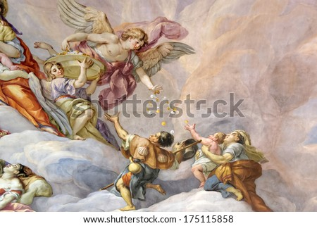 VIENNA, AUSTRIA - NOVEMBER 23,2013: The Karlskirche (St. Charles's Church). Vibrant frescoes of saints and angels decorate the vaulted interior dome of Karlskirche in Vienna. - stock photo