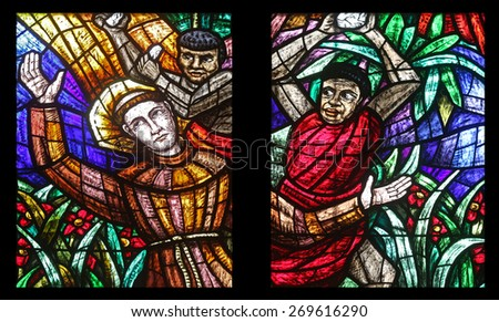 VIENNA, AUSTRIA - OCTOBER 11: Africa window, Stained glass in Votiv Kirche (The Votive Church). It is a neo-Gothic church located on the Ringstrabe in Vienna, Austria on October 11, 2014 - stock photo