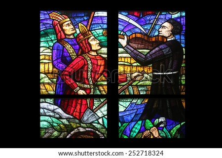 VIENNA, AUSTRIA - OCTOBER 11: America Window, Stained glass in Votiv Kirche (The Votive Church). It is a neo-Gothic church in Vienna, Austria on October 11, 2014 - stock photo