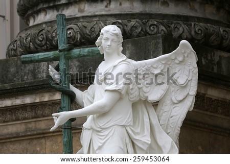 VIENNA, AUSTRIA - OCTOBER 10: Angel statue in front of Karlskirche church in Vienna, Austria on October 10,2011 in Vienna, Austria. - stock photo
