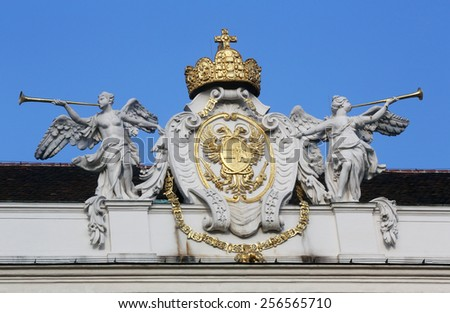 VIENNA, AUSTRIA - OCTOBER 10: Architectural decorations on Hofburg palace, Vienna; Austria. Hofburg was residence of Habsburg dynasty, rulers of Austro-Hungarian Empire. Vienna on October 10, 2014. - stock photo
