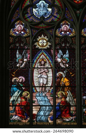 VIENNA, AUSTRIA - OCTOBER 10: Baptism of the Christ, Stained glass in Votiv Kirche (The Votive Church). It is a neo-Gothic church located on the Ringstrabe in Vienna, Austria on October 10, 2014 - stock photo