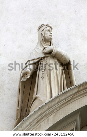 VIENNA, AUSTRIA - OCTOBER 10: Catherine of Siena on the facade of Dominican Church in Vienna, Austria on October 10, 2014. Famous baroque church was completed in 1634.