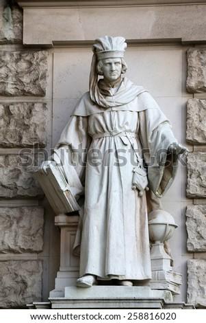 VIENNA, AUSTRIA - OCTOBER 10: Edmund Hofmann von Aspernburg: Magister, on the facade of the Neuen Burg on Heldenplatz in Vienna, Austria on October 10, 2014. - stock photo