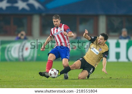 VIENNA, AUSTRIA - OCTOBER 22 Gabi (#14 Atletico) and Philipp Hosiner (#16 Austria) fight for the ball at a UEFA Champions League game on October 22, 2013 in Vienna, Austria. - stock photo