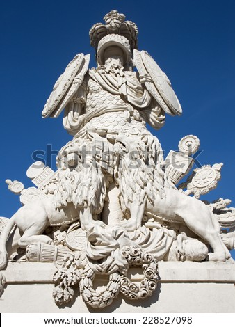 VIENNA, AUSTRIA - OCTOBER 19, 2014:  Gloriette in Schonbrunn palace and statue of guardians. Built in 1775 designed by architect Johann Ferdinand Hetzendorf von Hohenberg.