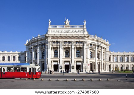 VIENNA, AUSTRIA - OCTOBER 8, 2010: Historic Burgtheater (Court Theatre) at the famous Wiener Ringstrasse with people and the tramway in front. Its one of the most important German language theatres. - stock photo
