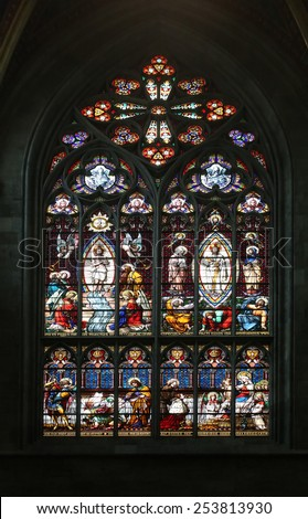 VIENNA, AUSTRIA - OCTOBER 11: Jesus' baptism and the Transfiguration on Mount Tabor, Stained glass in Votiv Kirche (The Votive Church). It is a neo-Gothic church in Vienna, Austria on October 11, 2014 - stock photo