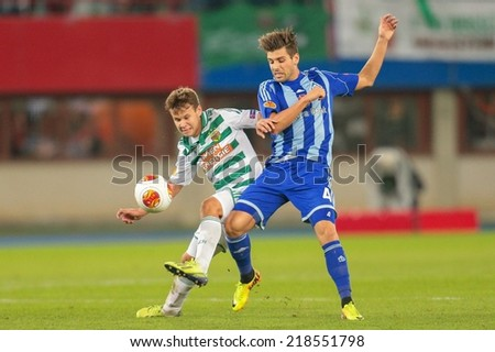 VIENNA, AUSTRIA - OCTOBER 3 Louis Schaub (#21 Rapid) and Miguel Veloso (#4 Kiew) fight for the ball at a UEFA Europa League game on OCTOBER 3, 2013 in Vienna, Austria. - stock photo