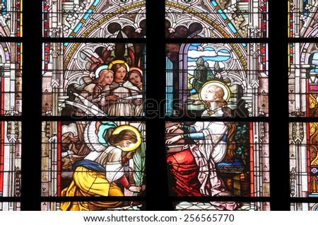 VIENNA, AUSTRIA - OCTOBER 11: Saint Cecilia, stained glass in Minoriten kirche in Vienna, Austria on October 11, 2014. - stock photo