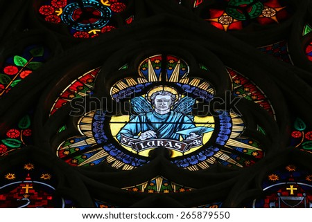 VIENNA, AUSTRIA - OCTOBER 10: Saint Luke the Evangelist, Stained glass in Votiv Kirche (The Votive Church). It is a neo-Gothic church located on the Ringstrabe in Vienna, Austria on October 10, 2014 - stock photo