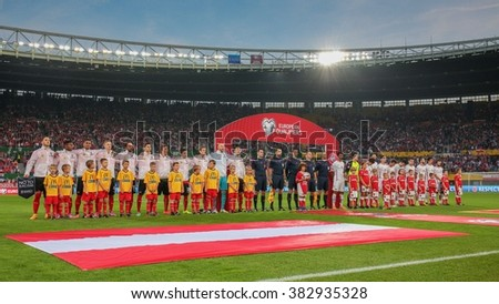 VIENNA, AUSTRIA - OCTOBER 12, 2014: The teams of Austria  and Montenegro pose before the game against Austria in an European Championship qualifying game. - stock photo