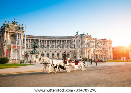 VIENNA, AUSTRIA - OCTOBER 19, 2015: Traditional old-fashioned fiacre in Hofburg, Vienna, Austria - stock photo