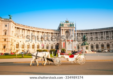 VIENNA, AUSTRIA - OCTOBER 19, 2015: Traditional old-fashioned fiacre in Hofburg, Vienna, Austria