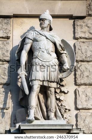 VIENNA, AUSTRIA - OCTOBER 10: Wilhelm Seib: Roman soldier, on the facade of the Neuen Burg on Heldenplatz in Vienna, Austria on October 10, 2014. - stock photo