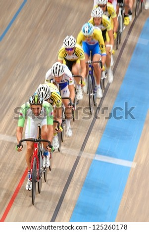 VIENNA,  AUSTRIA - SEPTEMBER 28  Andreas Graf (Austria) leads the peloton in the men's scratch race of an indoor cycling meeting on September 28, 2012 in Vienna, Austria. - stock photo
