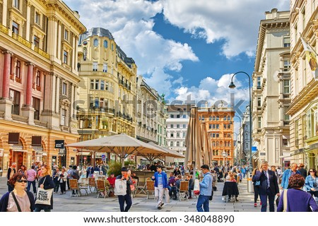 VIENNA, AUSTRIA- SEPTEMBER 10, 2015: Cityscape  views of one of Europe's most beautiful town- Vienna. Peoples on streets, urban life in Vienna. Austria - stock photo
