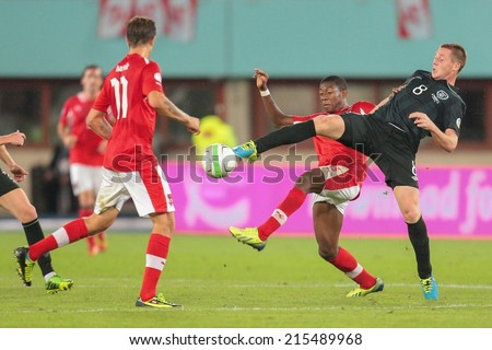 VIENNA, AUSTRIA - SEPTEMBER 10 David Alaba (#8 Austria) and James McCarthy (#8 Ireland) fight for the ball at a World Cup Qualifying game on September 10, 2013 in Vienna, Austria. - stock photo