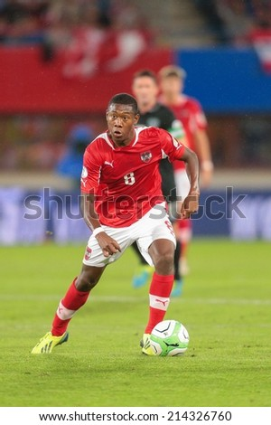 VIENNA, AUSTRIA - SEPTEMBER 10 David Alaba (#8 Austria) runs with the ball at a World Cup Qualifying game on September 10, 2013 in Vienna, Austria. - stock photo