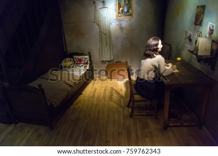 VIENNA, AUSTRIA - SEPTEMBER 11, 2016 : Detailed waxwork figure view of famous writer Anne Frank, wax sculpture exhibited in Madame Tussauds museum in Vienna.