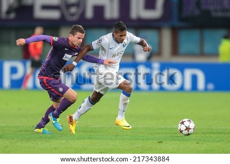 VIENNA, AUSTRIA - SEPTEMBER 18 Fernando (#25 Porto) and Tomas Simkovic (#8 Austria) fight for the ball at a UEFA Champions League game on September 18, 2013 in Vienna, Austria. - stock photo