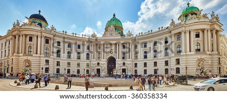 VIENNA, AUSTRIA-SEPTEMBER 10, 2015: Hofburg Palace seen from Michaelerplatz, wide-angle view at sunny day with tourists and people.Vienna.Austria. - stock photo