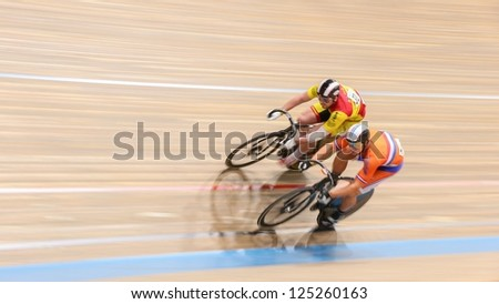 VIENNA,  AUSTRIA - SEPTEMBER 28  Jakub Vyvoda (Czech Repbulic) and Jeffrey Hoogland (Netherlands) compete in the men's keirin event of a cycling meeting on September 28, 2012 in Vienna, Austria.