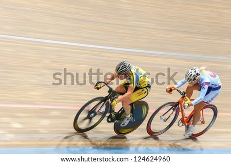 VIENNA,  AUSTRIA - SEPTEMBER 27  Lucie Zaleska (Czech Republic) and Alzbeta Pavlendova (Slovakia) compete in the women's scratch event of a cycling meeting on September 27, 2012 in Vienna, Austria. - stock photo