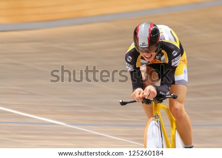VIENNA,  AUSTRIA - SEPTEMBER 28  Patrick Jaeger (Austria) competes in the men's juniors time trial of an indoor cycling meeting on September 28, 2012 in Vienna, Austria. - stock photo