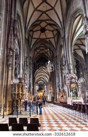 VIENNA, AUSTRIA - SEPTEMBER 27, 2015: people in nave of St Stephen's Cathedral, Vienna. Stephansdom is the mother church of Roman Catholic Archdiocese of Vienna and the seat of Archbishop of Vienna