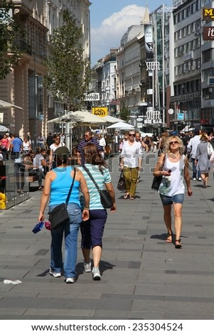 VIENNA, AUSTRIA - SEPTEMBER 5, 2011: People stroll in Karntner Strasse in Vienna. As of 2008, Vienna was the 20th most visited city worldwide (by international visitors). - stock photo