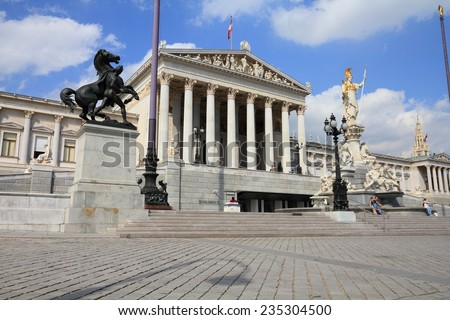 VIENNA, AUSTRIA - SEPTEMBER 5, 2011: People visit the Parliament in Vienna. As of 2008, Vienna was the 20th most visited city worldwide (by international visitors).